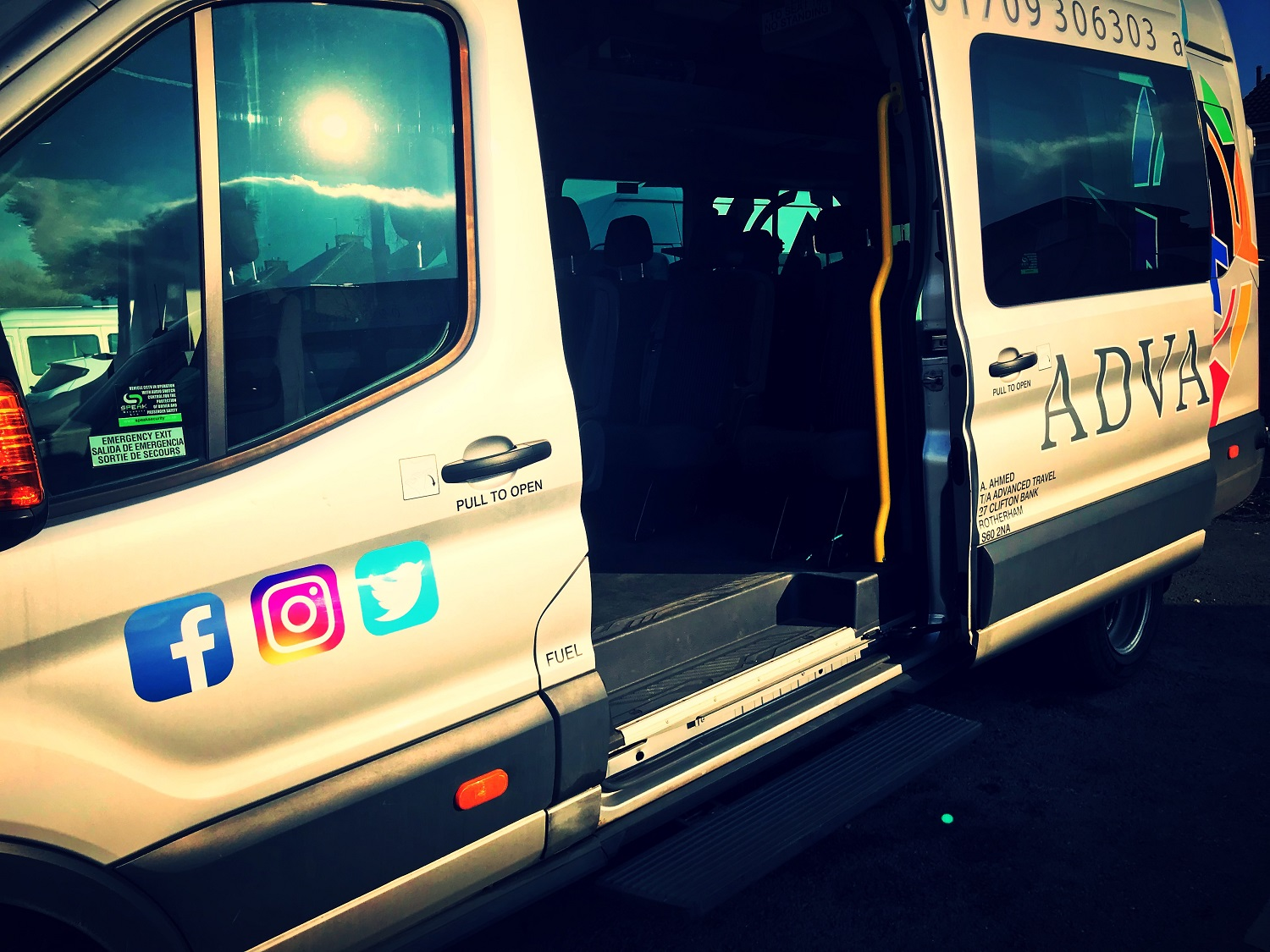 The sliding passenger door of our 16 Seater Ford Transit minibus, with electric lowered step and safety handrail.